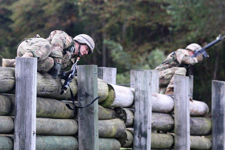 Ranger Challenge Cadets vault a wooden barrier