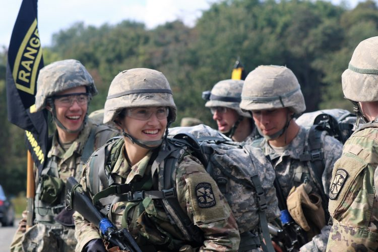 Ranger Challenge Cadets smile after completing a foot march