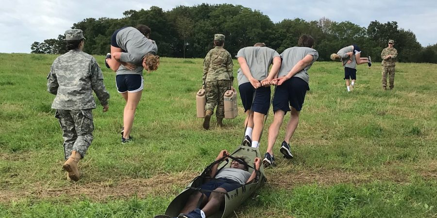 UConn Swimming and Diving Team performs casualty evacuation during sports challenge