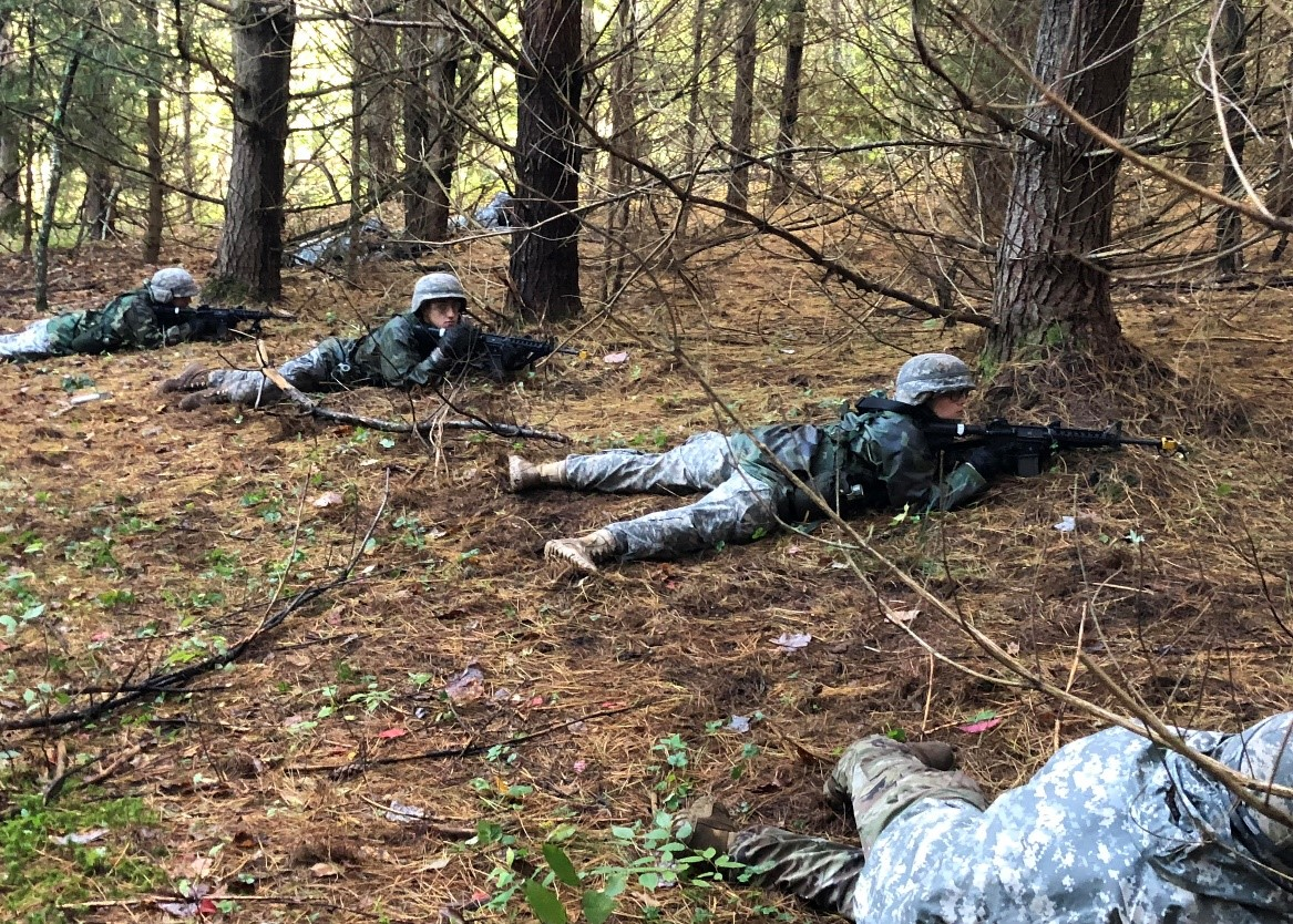 Cadets lay in security during a squad attack lane