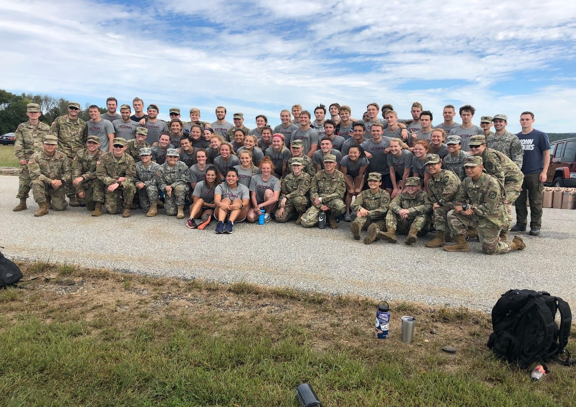 UConn Swim Team takes a group photo with ROTC Cadets