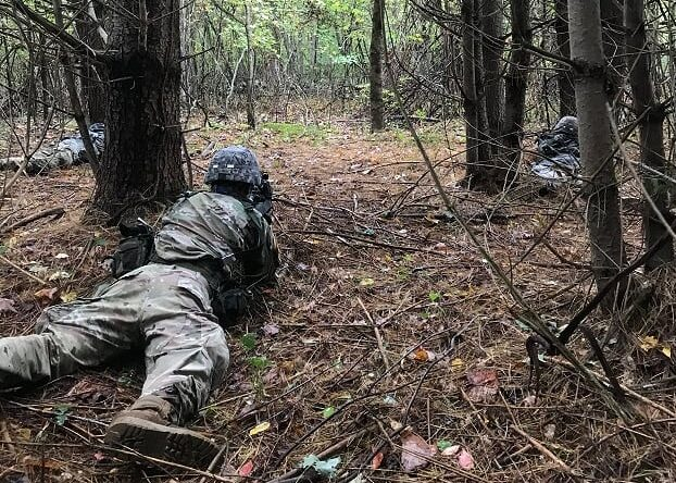 Cadets prone in security during the Fall Field Training Exercise