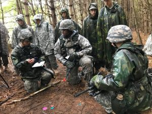 Junior ROTC Cadet delivers a brief prior to executing a mission