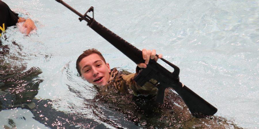 Cadet swims with rifle above water