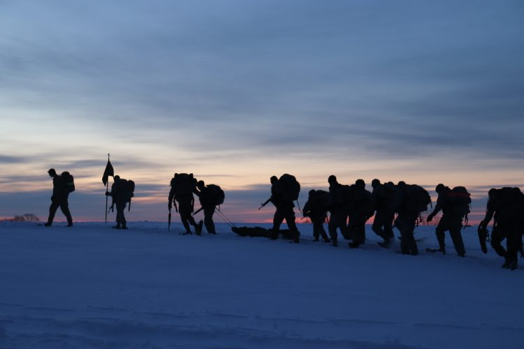 Ranger Challenge cadets snow shoe at sunrise
