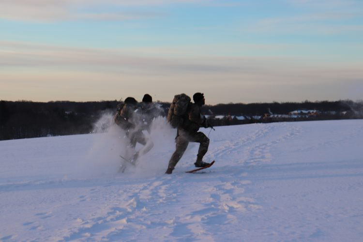 Ranger Challenge cadets sprint in snow shoes on Horsebarn Hill