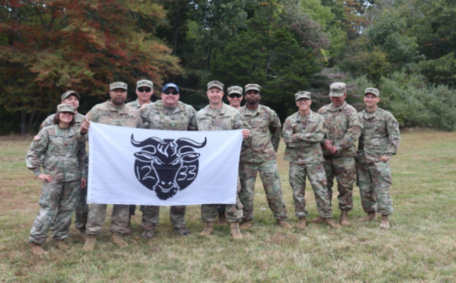 CPT Christopher Young and his Soldiers from MAT 1233 pose for a photo with the PMS and SMI, LTC Christopher Morris and MSG Christopher Crayton.